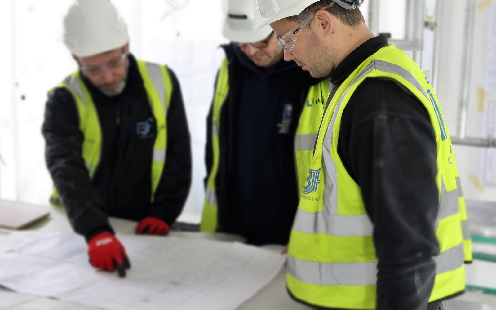 BJF Construction workers on site looking at drawings