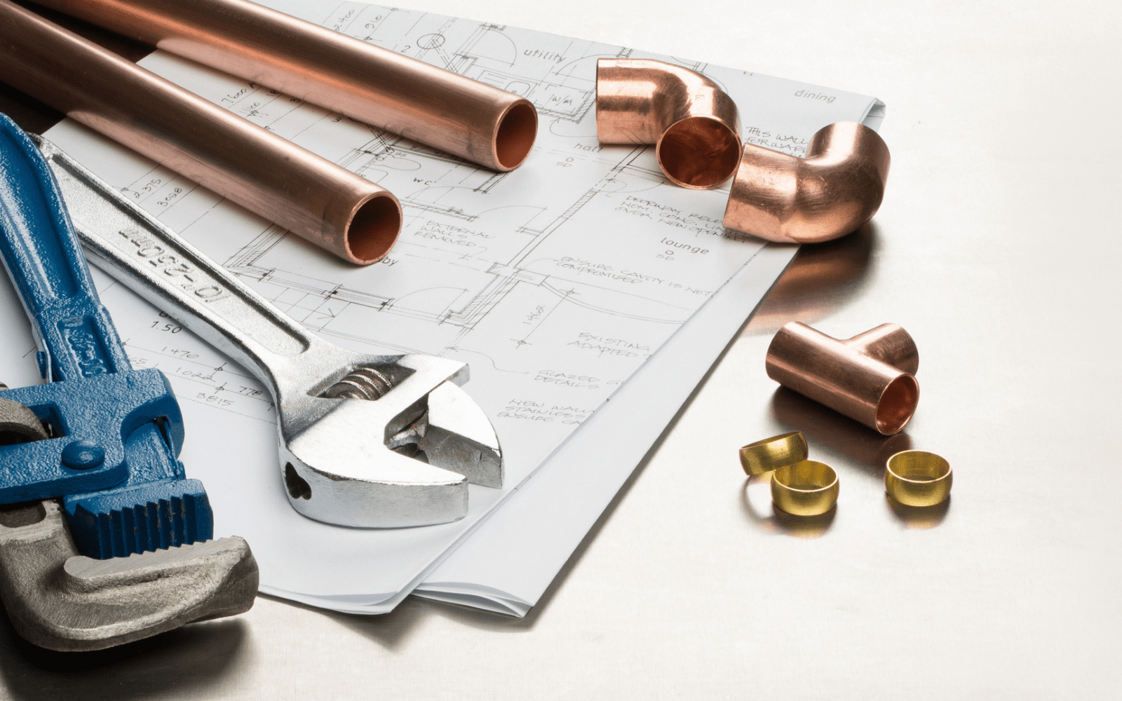 Plumbing wrenches and pipes